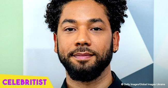 Jussie Smollett hugs his co-star in red pantsuit after revealing their 'chemistry'