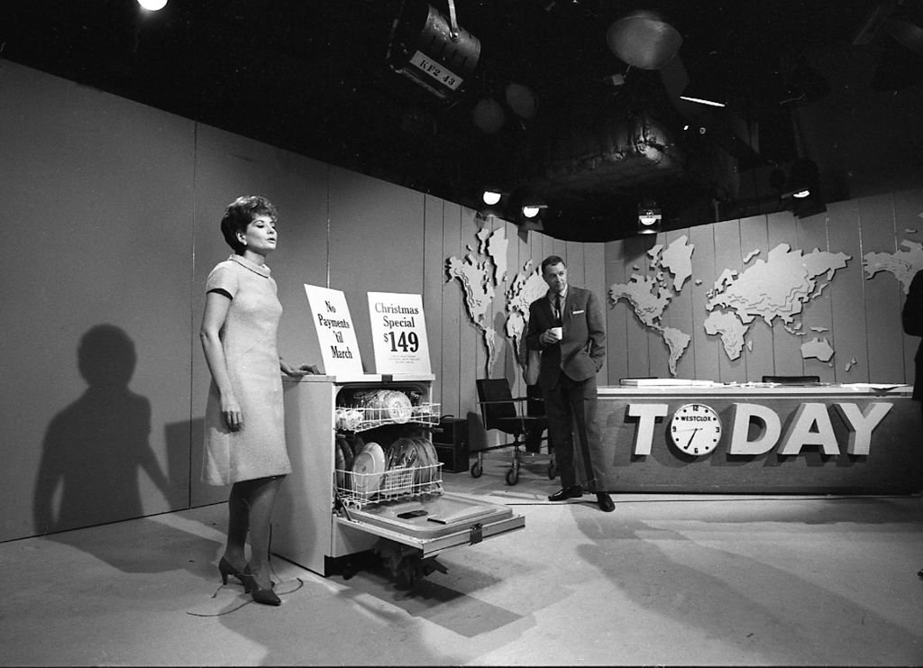 American broadcast journalists Barbara Walters and Hugh Downs (right) stand with a dishwasher on the 'Today' show set, New York, New York, 1966.   Source: Getty Images