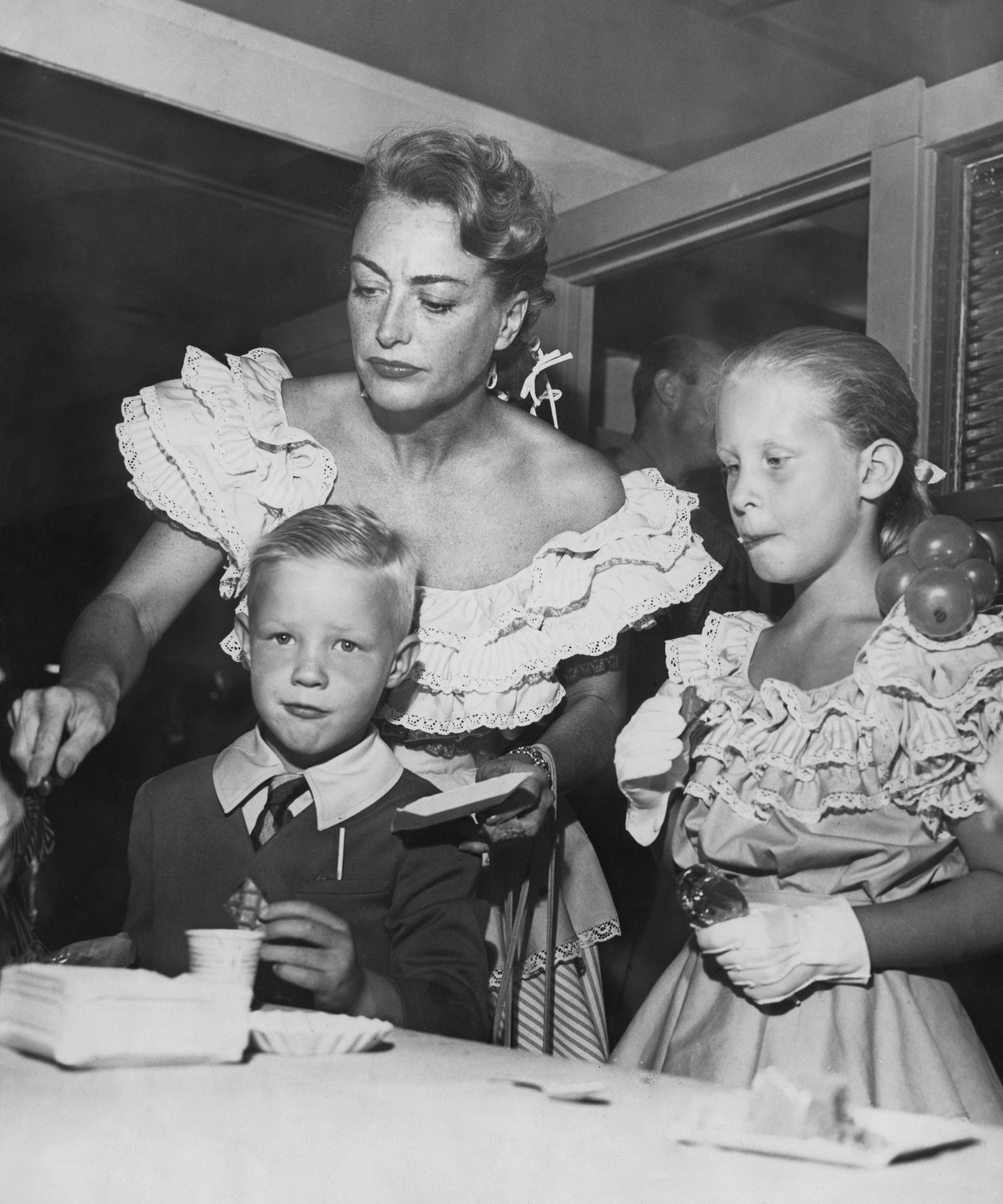 American actress Joan Crawford with her children Christopher and Christina, circa 1947.   Source: Getty Images