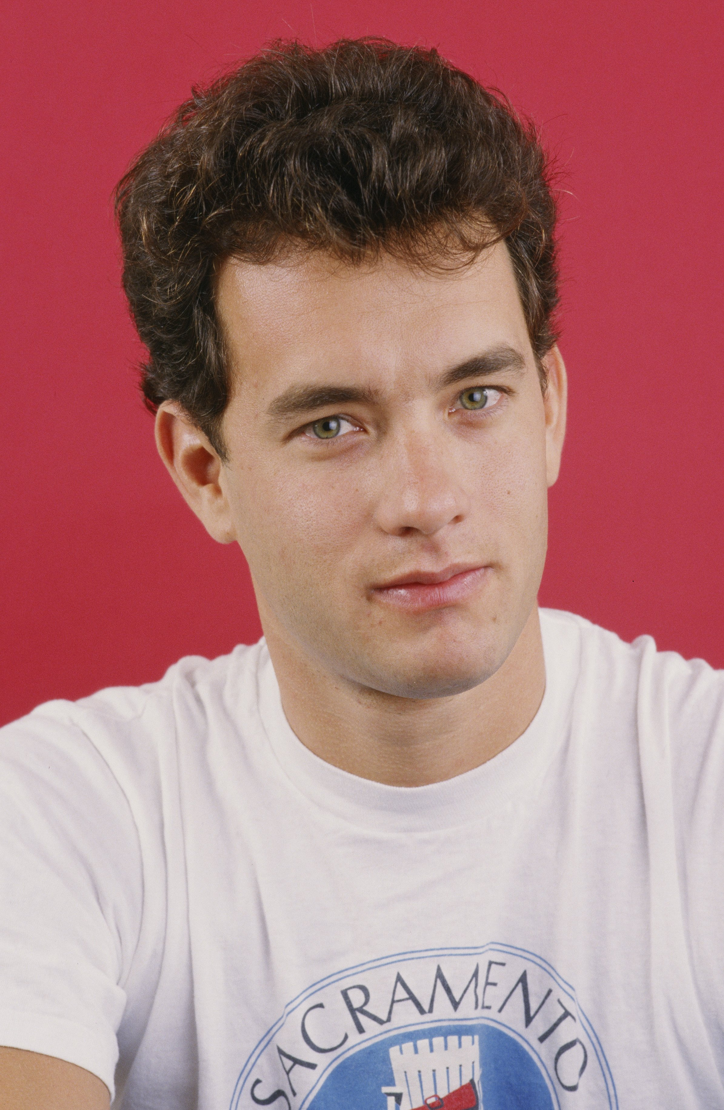 """Tom Hanks poses during a 1986 West Hollywood, California studio photo session to promote his movie """"The Money Pit."""" 