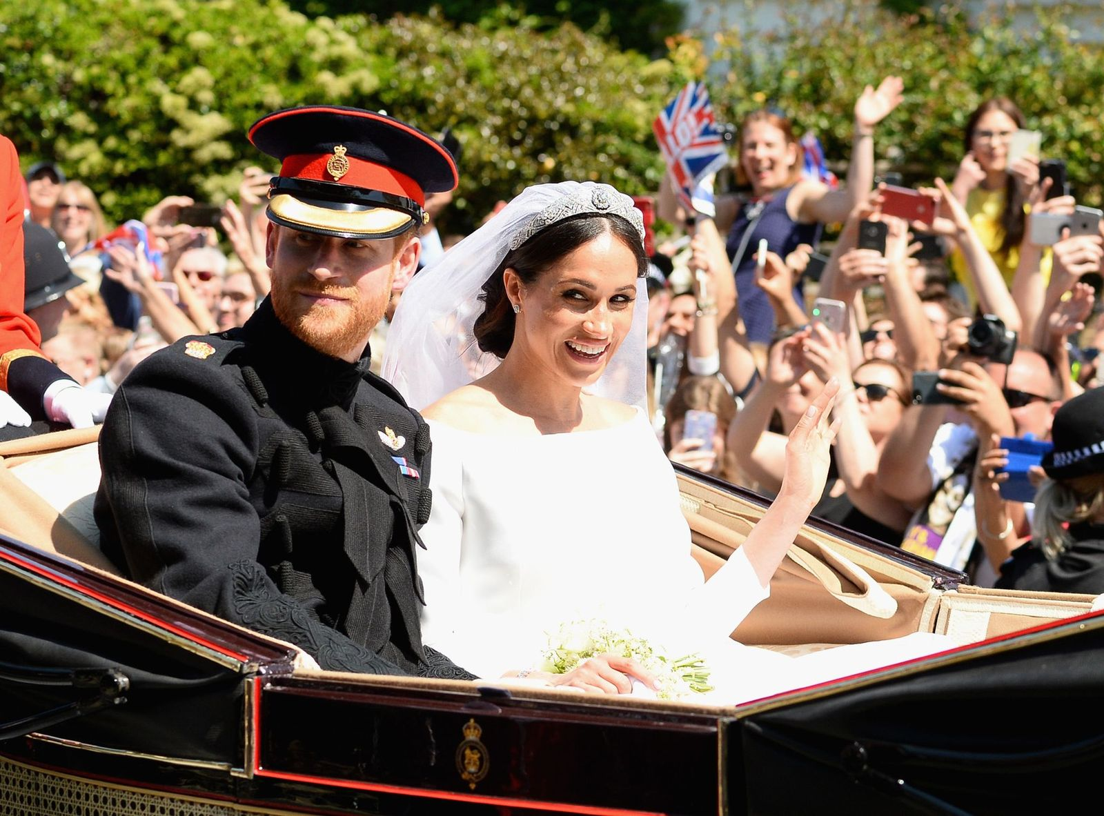 Prince Harry and Meghan Markle after getting married at St Georges Chapel on May 19, 2018 in Windsor, England | Photo: Getty Images
