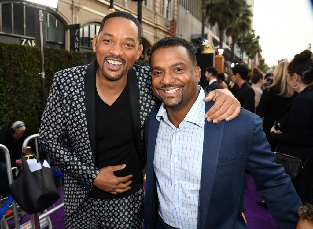 "Will Smith and Alfonso Ribeiro attends the premiere of Disney's ""Aladdin"" at El Capitan Theatre on May 21, 2019 