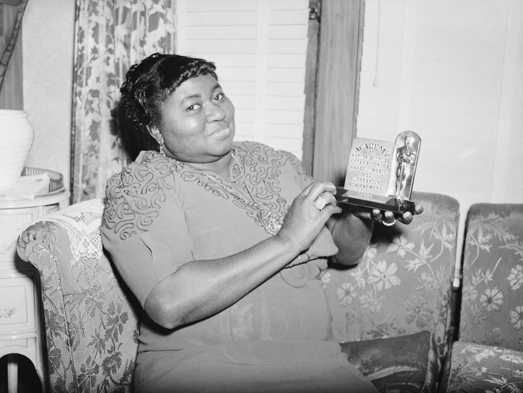 """Hattie McDaniel with her Academy Award for """"Gone with the Wind"""" circa 1940 