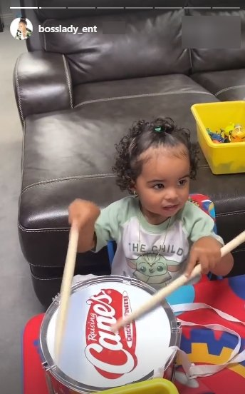 A picture of Shante Broadus' granddaughter beating a drum. | Photo: Instagram/Bosslady_ent