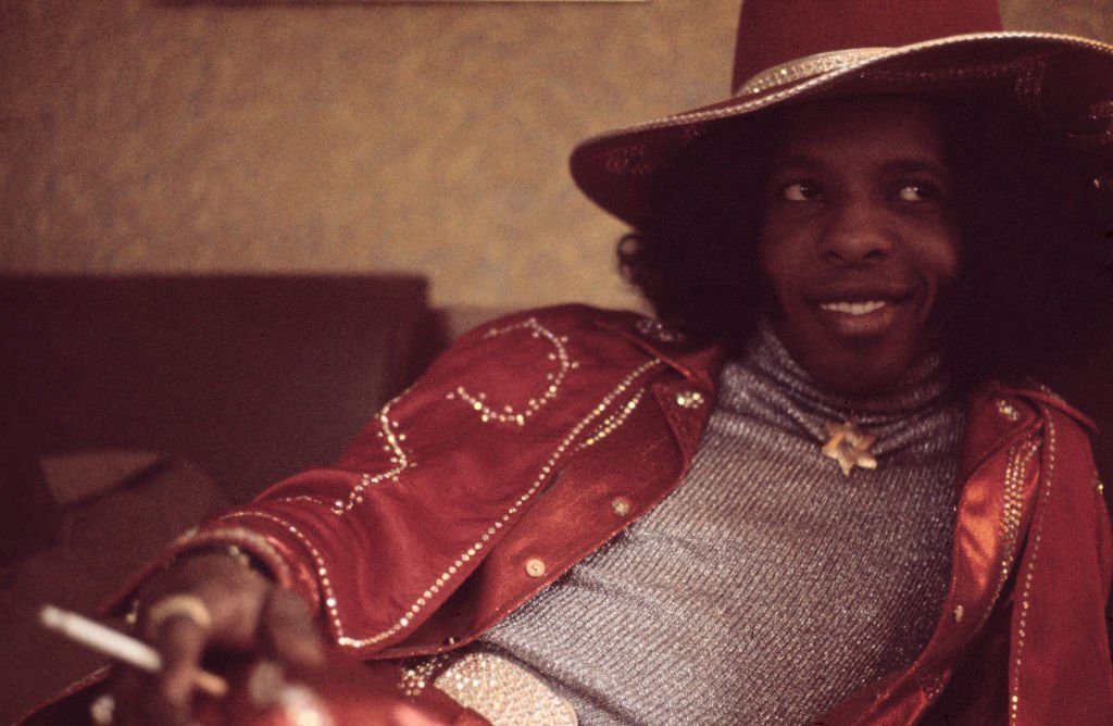 Sly Stone of Sly And The Family Stone posed smoking a cigarette in London on 16th July 1973.   Photo: Getty Images