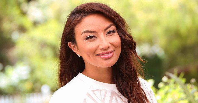 Jeannie Mai of 'The Real' Flaunts Her Toned Physique While Basking in the Sun in a Yellow Bikini