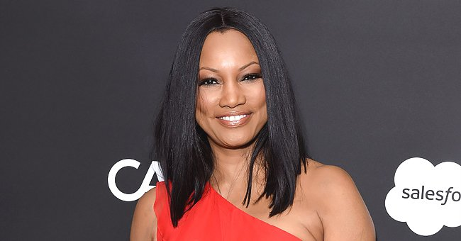 Garcelle Beauvais Flaunts Curvy Figure in Cropped Shirt, Military Pants & a Matching Face Mask