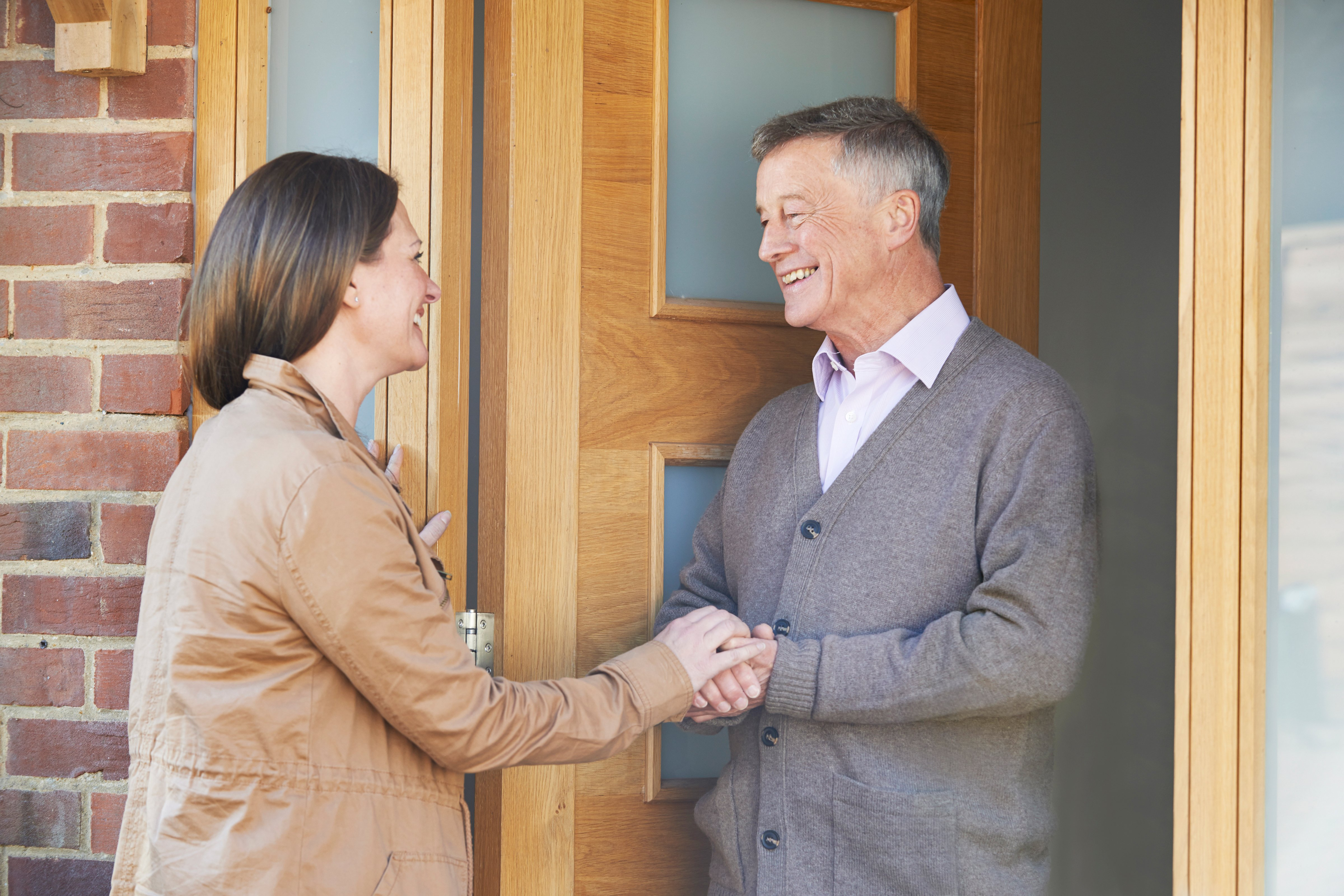 A Woman discussing with her elderly male neighbor. | Photo: Shutterstock