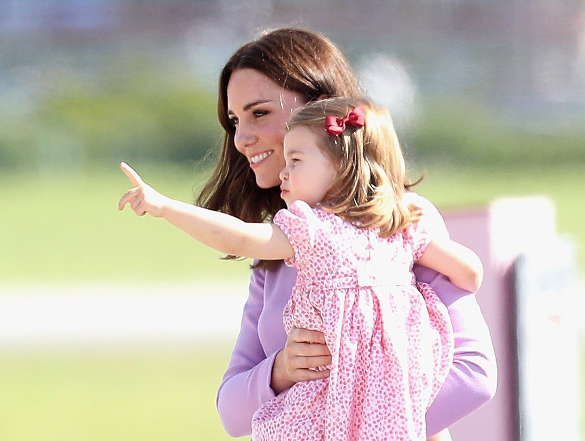 Duchess of Cambridge and Princess Charlotte before departing from Hamburg airport on the last day of their official visit to Poland and Germany on July 21, 2017. | Source: Getty Images
