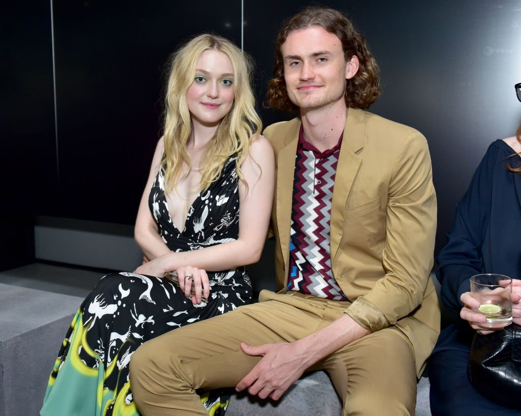 Dakota Fanning and Henry Frye attends the Prada Resort 2019 fashion show in New York City on May 4, 2018 | Photo: Getty Images