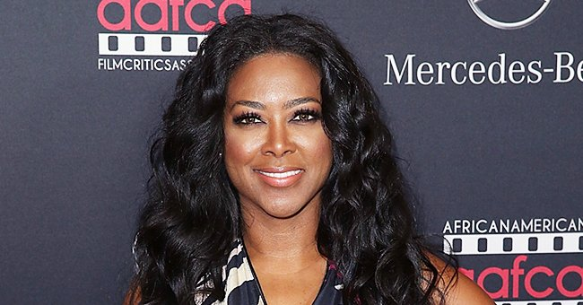 Kenya Moore's Daughter Brooklyn Focuses on a Book Her Dad Marc Is Reading Her in an Adorable New Pic