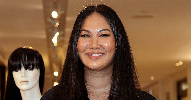 Kimora Lee Simmons' Daughter Aoki Is Barely Recognizable Posing In Trendy Tights in a New Photo