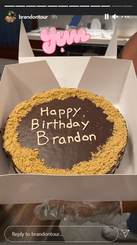 """A picture of a cake with the words """"Happy Birthday Brandon"""" inscribed on it. 