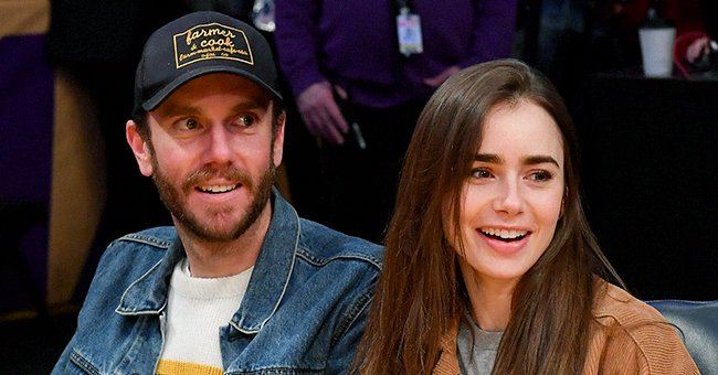Lily Collins and her husband Charlie McDowell watches the basketball game between the Los Angeles Lakers and the Cleveland Cavaliers at Staples Center on January 13, 2020. | Photo: Getty Images