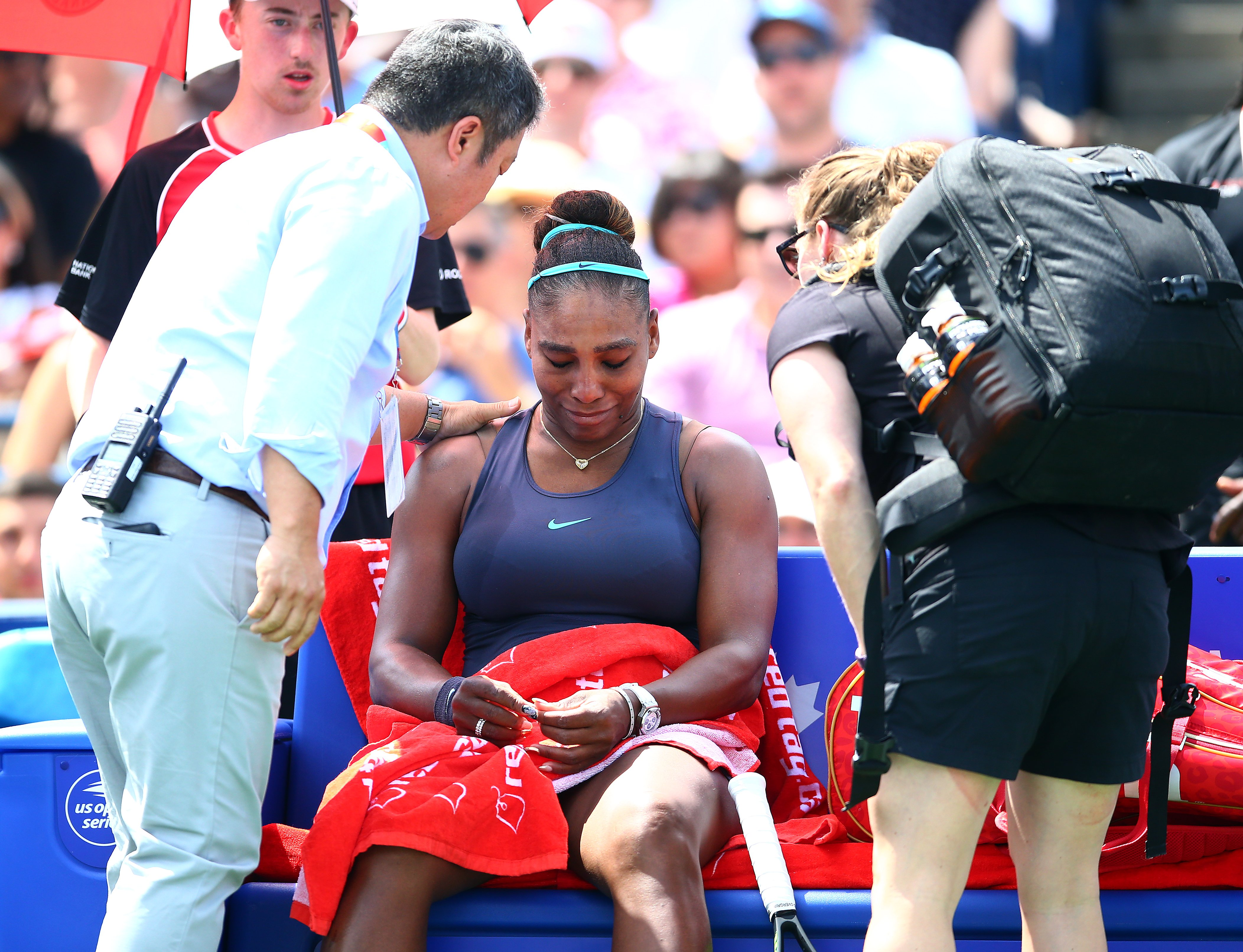 Serena Williams sitting on a bench after suffering a back injury at the 2019 Rogers Cup in Toronto, Canada.   Photo: Getty Images
