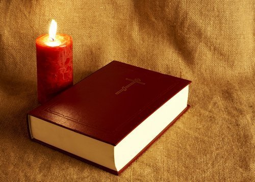 Bible in the textile background.  Photo: Shutterstock.