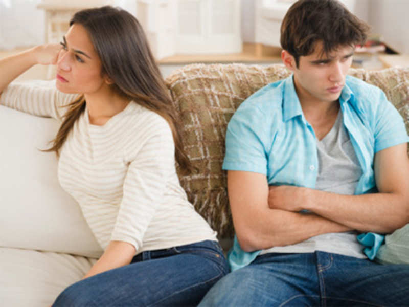 A man and a woman having an argument in their living room | Photo: Shutterstock