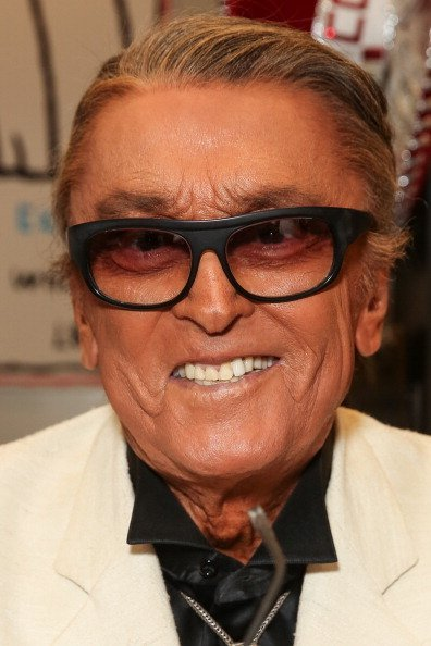 """Producer Robert Evans signs copies of his new book """"The Kid Stays In The Picture"""" at Book Soup on July 31, 2013 in West Hollywood, California 