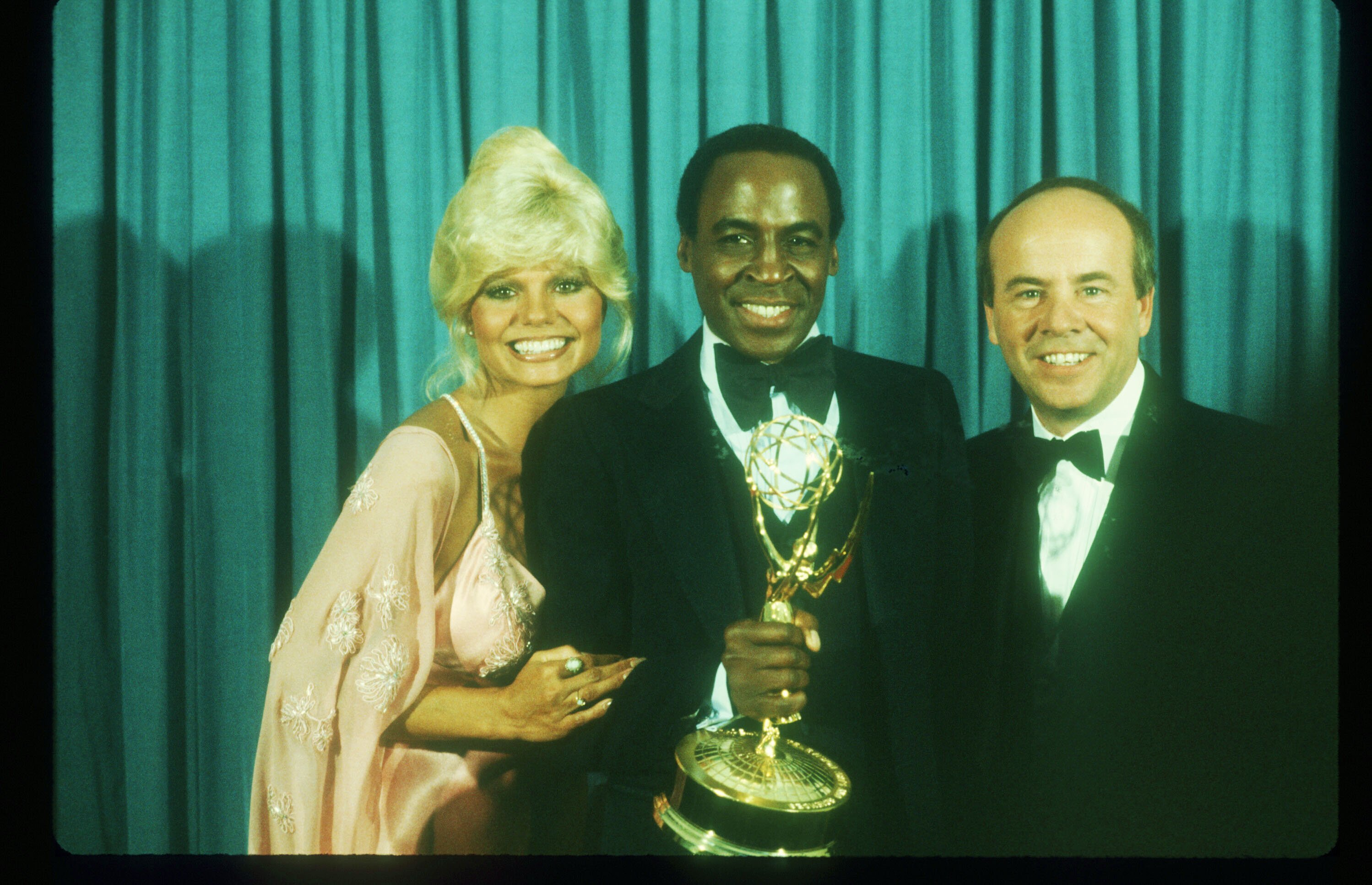 Loni Anderson, Robert Guillaume, and Tim Conway pose for a picture August 1979 after he won the Emmy for his role as Benson on the TV show 'soap.'' | Source: Getty Images