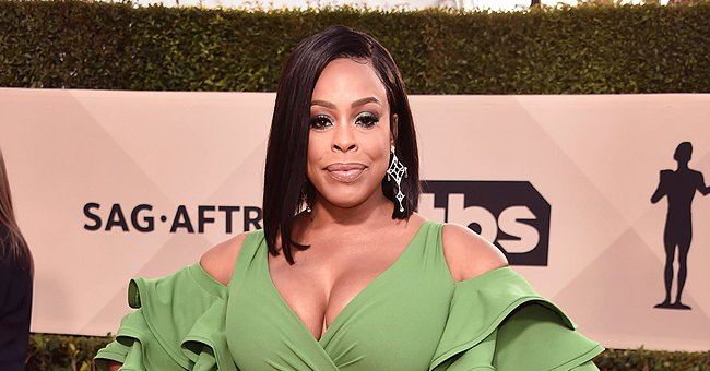 'Claws' Star Niecy Nash Pours Her Curves into a Cleavage Revealing Jaguar-Printed Jumpsuit