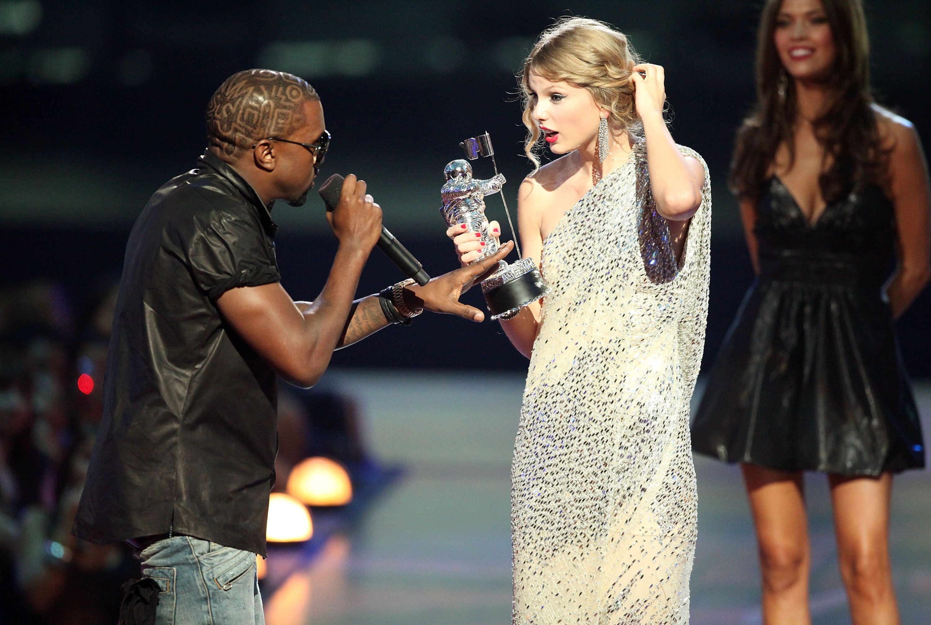 """Kanye West jumps onstage after Taylor Swift won the """"Best Female Video"""" award during the 2009 MTV Video Music Awards at Radio City Music Hall on September 13, 2009, in New York City. 
