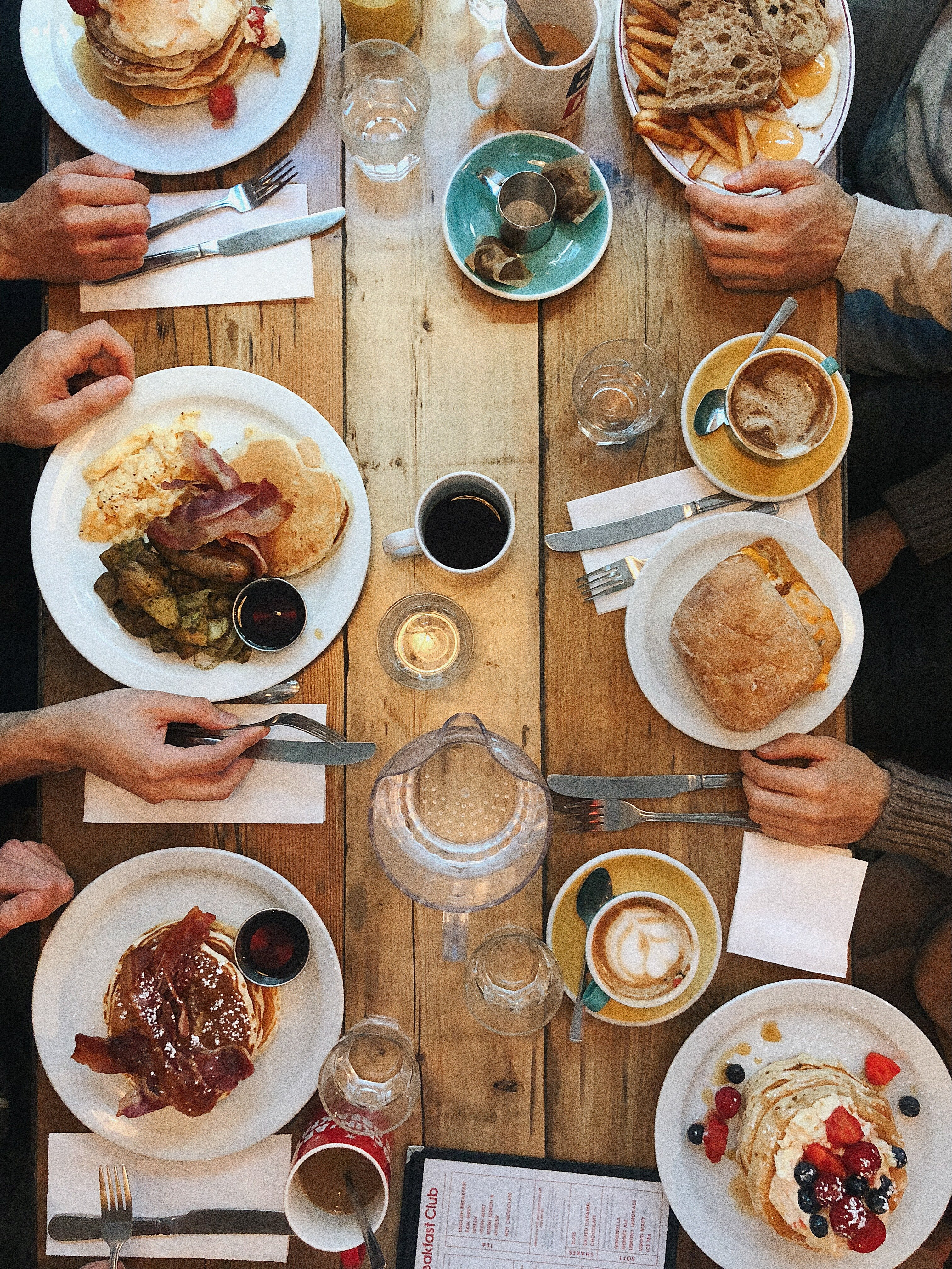 A long table filled with food.   Pexels