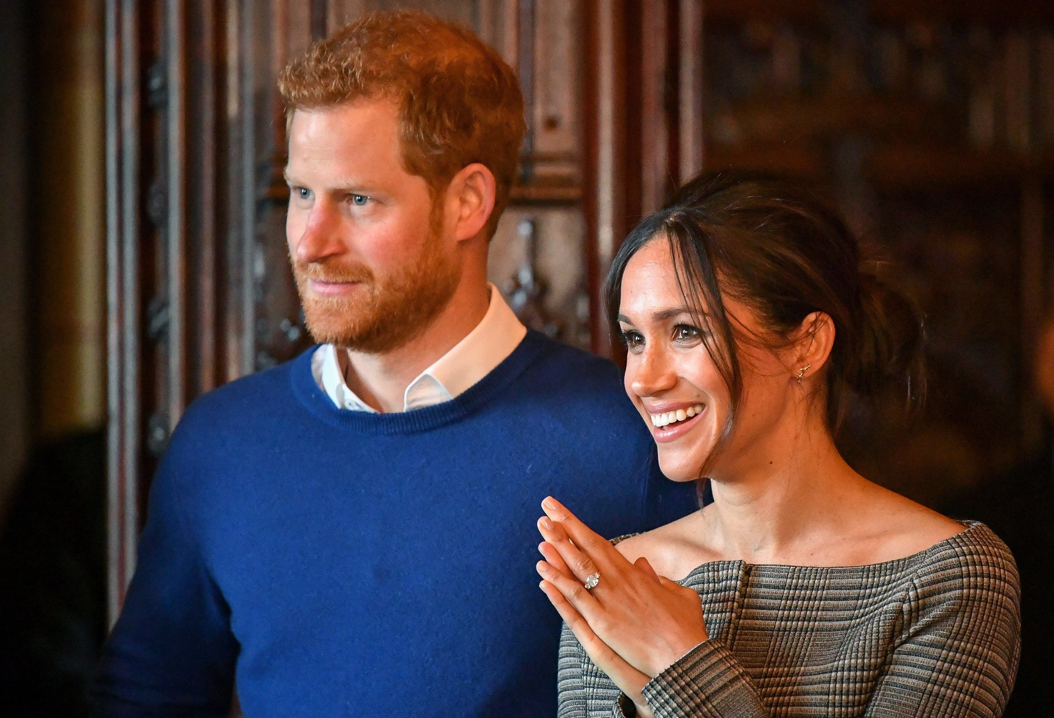 Prince Harry and Meghan Markle watch a performance by a Welsh choir in the banqueting hall during a visit to Cardiff Castle on January 18, 2018|Photo: Getty Images