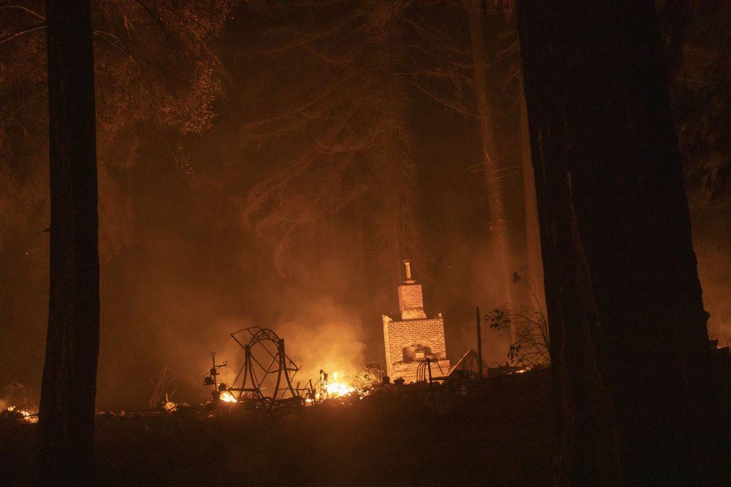 A chimney remains where a home burned off Highway 236 during the CZU Lightning Complex fire in Santa Cruz | Photo: Getty images