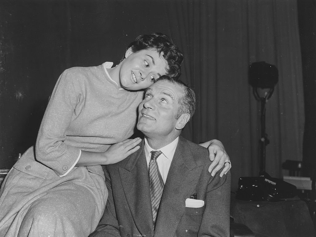 """Sir Laurence Olivier and Joan Plowright embracing as they rehearse a scene from the play """"The Entertainer,"""" in 1957 