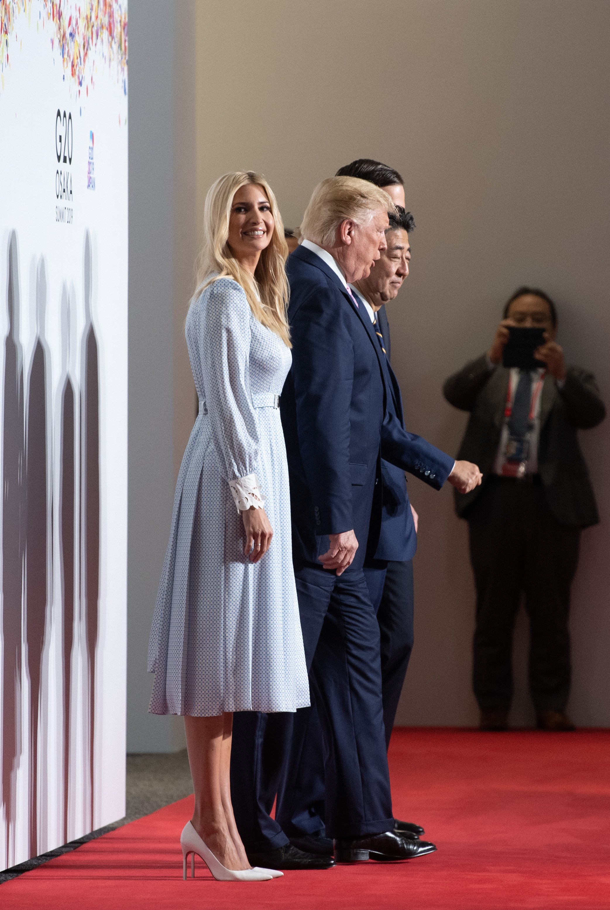 Ivanka Trump with Donald Trump and Japan's Prime Minister Shinzo Abe posing for a group photo at the G20 summit in Osaka, Japan | Photo: Getty Images