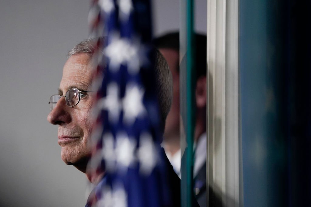 National Institute of Allergy and Infectious Diseases Director Anthony Fauci listens as U.S. President Donald Trump speaks during a briefing on the coronavirus pandemic, in the press briefing room of the White House on March 26, 2020   Photo: Getty Images