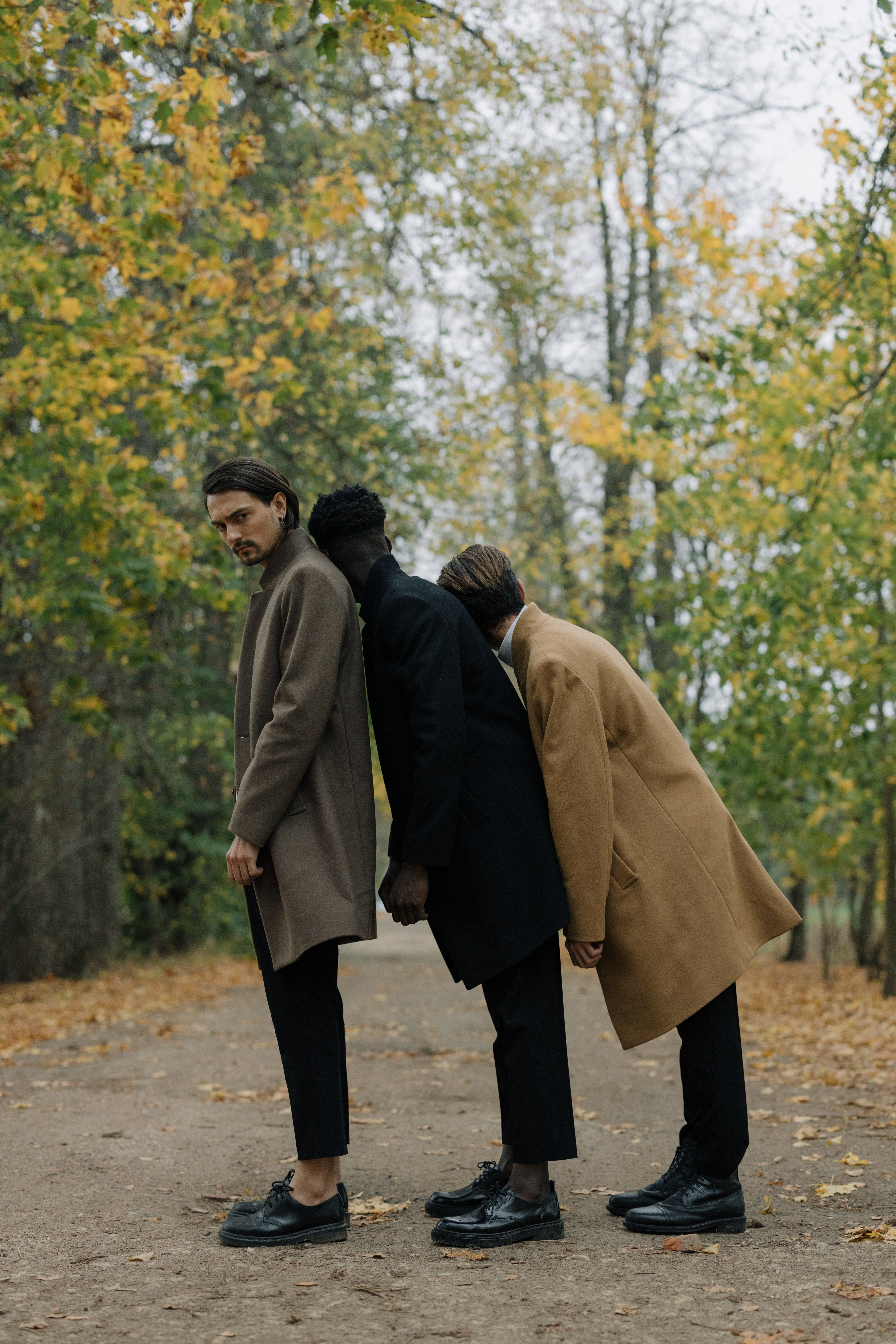 Pictured - The males standing near trees | Source: Pexels