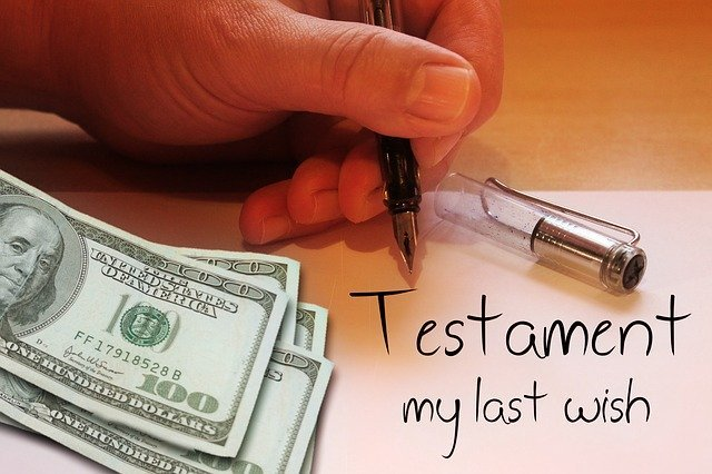 "Someone holds a man with ""Testament my last wish"" written next to some money 