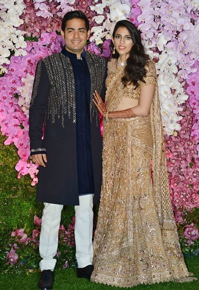 Akash Ambani and Shloka Mehta at their wedding party, in Mumbai | Photo: Getty Images
