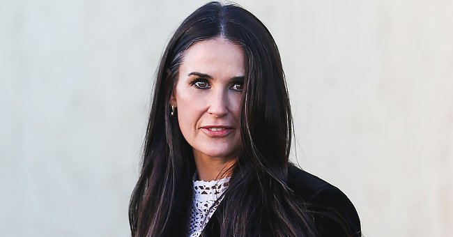 Demi Moore Flaunts Slim Figure as She Poses in Chic All-Black Outfit near a 1965 Porsche