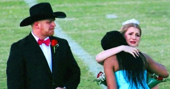 A homecoming queen prompts an emotional reaction as she hands her crown to another student who just lost her mother to cancer | Photo: Facebook/RickKarle