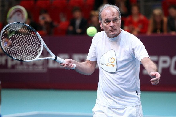 Laurent Baffie en action lors de l'Amelie Mauresmo Tennis Night au profit de l'Institut au Stade de Coubertin  à Paris, France. | Photo : Getty Images