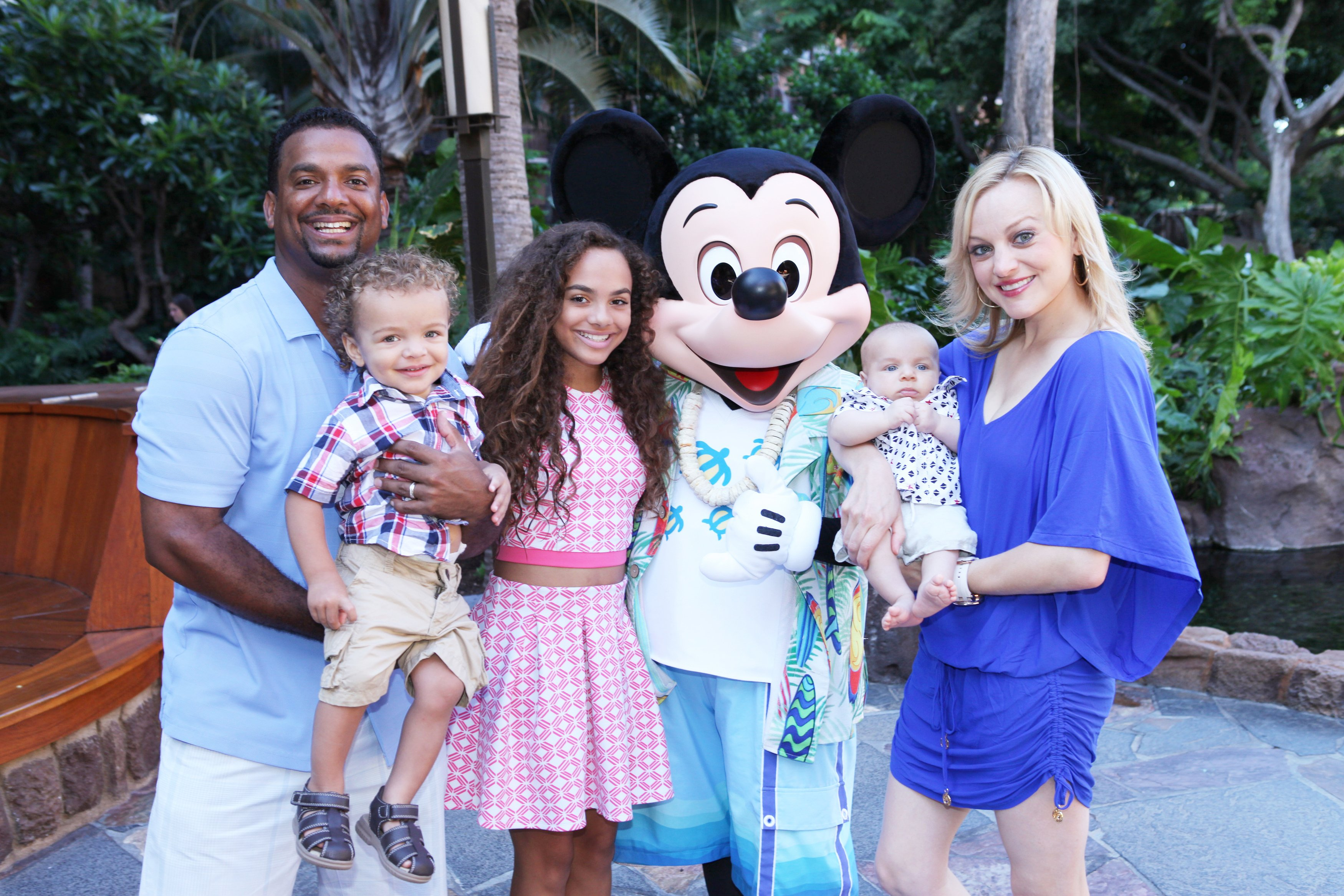 Alfonso Ribeiro, his wife Angela, and their 3 kids, pose at a Hawaiian Disney Resort & Spa on July 26, 2015.   Source: Getty Images
