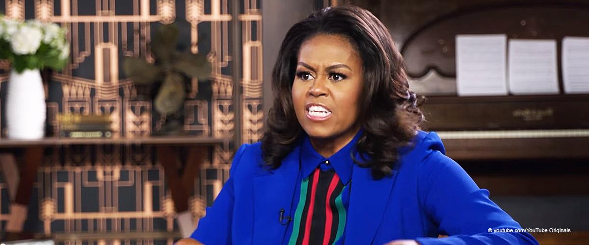 Michelle Obama sieht im gestreiften Hosenanzug klasse aus, als sie über Ehe mit Barack spricht