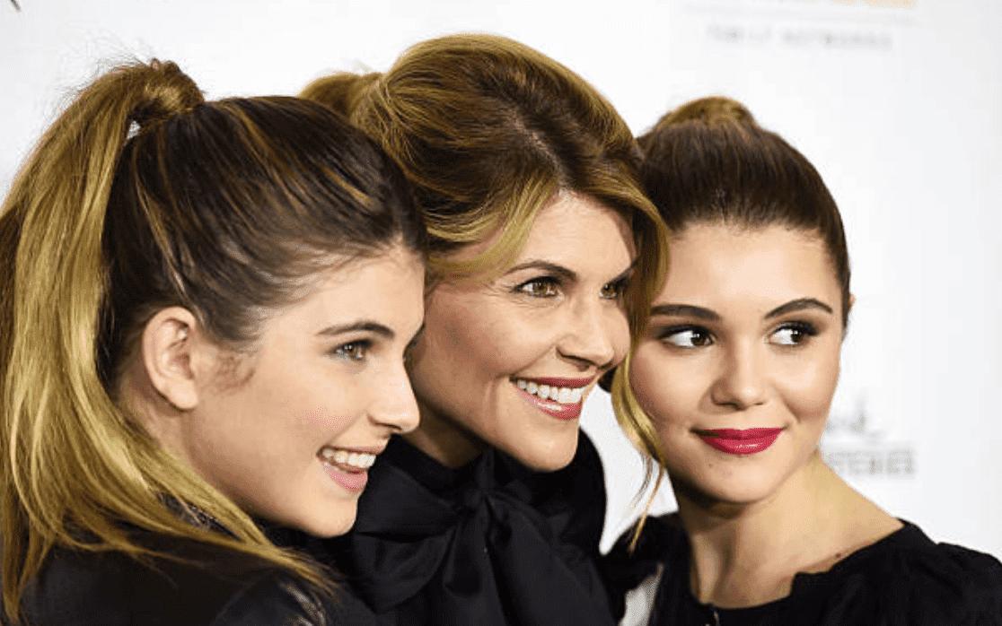 "Lori Loughlin, Isabella Giannulli and Olivia Giannulli on the red carpet for the premiere of ""Northpole,"" on November 4, 2014, in Los Angeles, California 