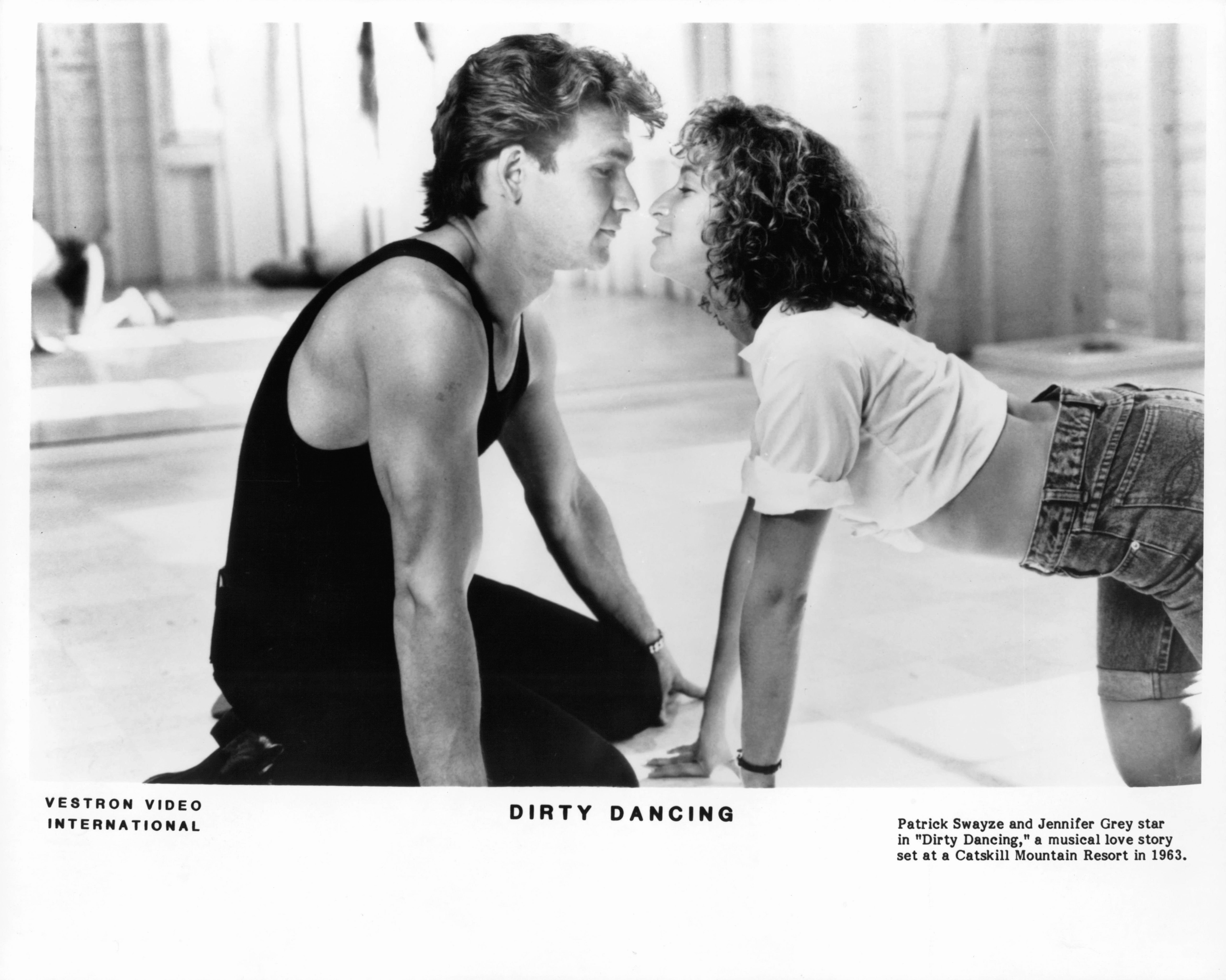 "Patrick Swayze as Johnny Castle and Jennifer Grey as Frances ""Baby"" Houseman during a scene of the iconic 1987 film ""Dirty Dancing"" 
