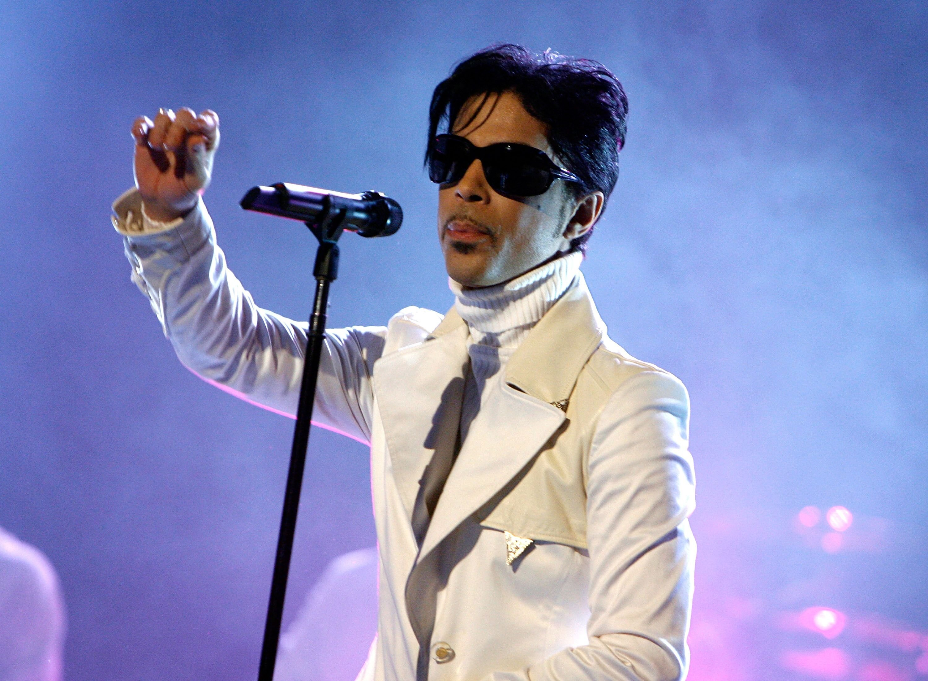Prince performing on-stage during a concert | Getty Images