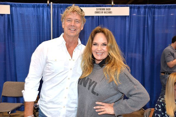 John Schneider and Catherine Bach at the Anaheim Convention Center at Anaheim, California on September 29, 2019. | Photo: Getty Images