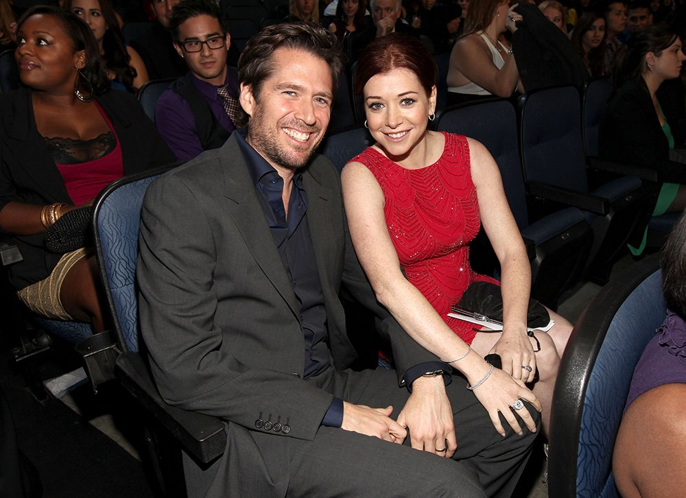 Alexis Denisof and Alyson Hannigan pose in the audience during the 2012 People's Choice Awards at Nokia Theatre L.A. Live on January 11, 2012 in Los Angeles, California. I Image: Getty Images.