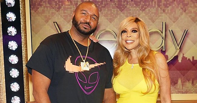 Wendy Williams Shows off Her Fit Figure Posing in a Bright Yellow Dress with DJ Suss One