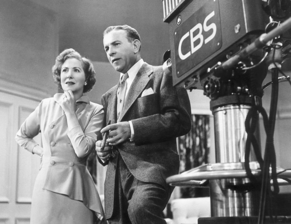 American comedy team George Burns (1896 - 1996) and Gracie Allen (1902 - 1964) standing next to a television camera on the set of their TV series 'The George Burns and Gracie Allen Show' on January 01, 1955. | Photo: Getty Images