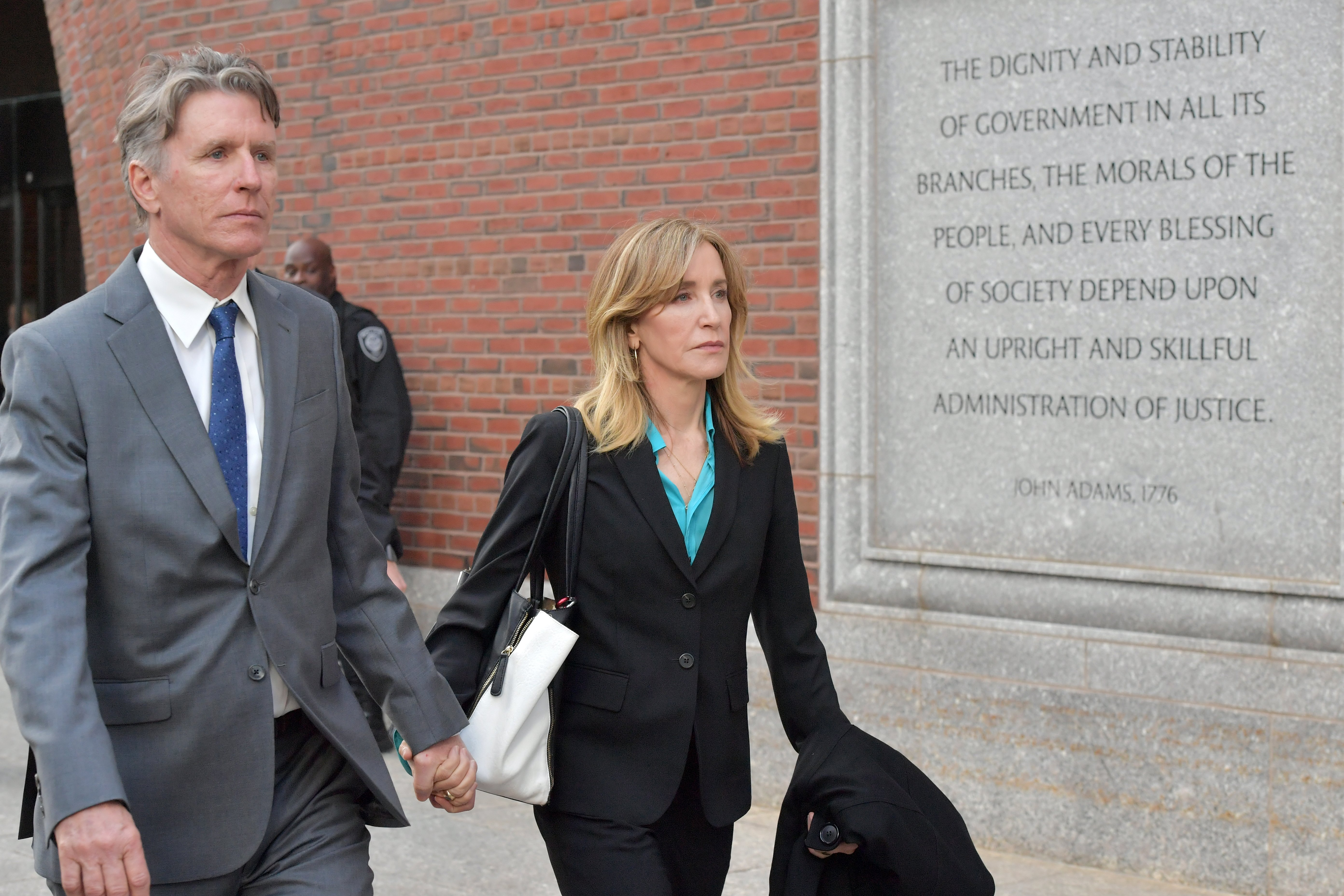 Felicity Huffman outside the John Joseph Moakley U.S. Courthouse in Boston, Massachusetts | Photo: Getty Images