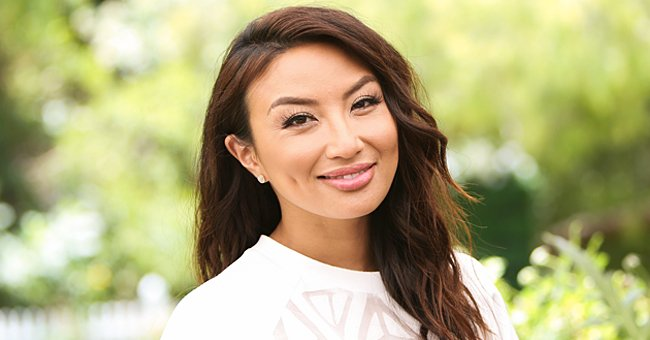 Jeannie Mai Flaunts Her Slim Figure in New Photo Wearing a Fitted Pink Dress & High Heels