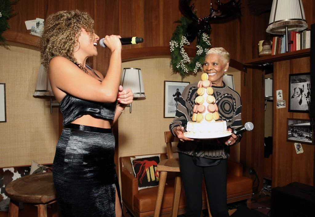Dionne Warwick holds her macaron tower as she is serenaded by her granddaughter,  Cheyenne Elliott for her 80th birthdaycduring her performance at Le Chalet on December 10, 2019. | Photo: Getty Images