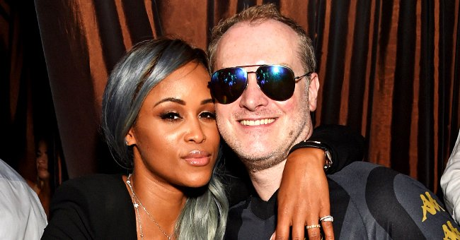Eve Stands Close to Her Billionaire Husband in a Selfie as They Pose with Expensive Cars